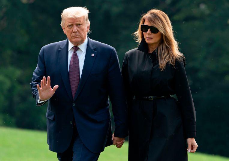 De Amerikaanse president Donald Trump en first lady Melania. (Archiefbeeld). Beeld AFP
