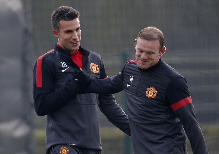 Van Persie (links) en Rooney tijdens de training. Beeld reuters