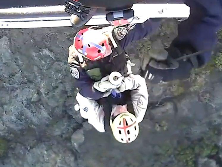 Wandelaar gered nadat hij klem raakt onder vallend rotsblok