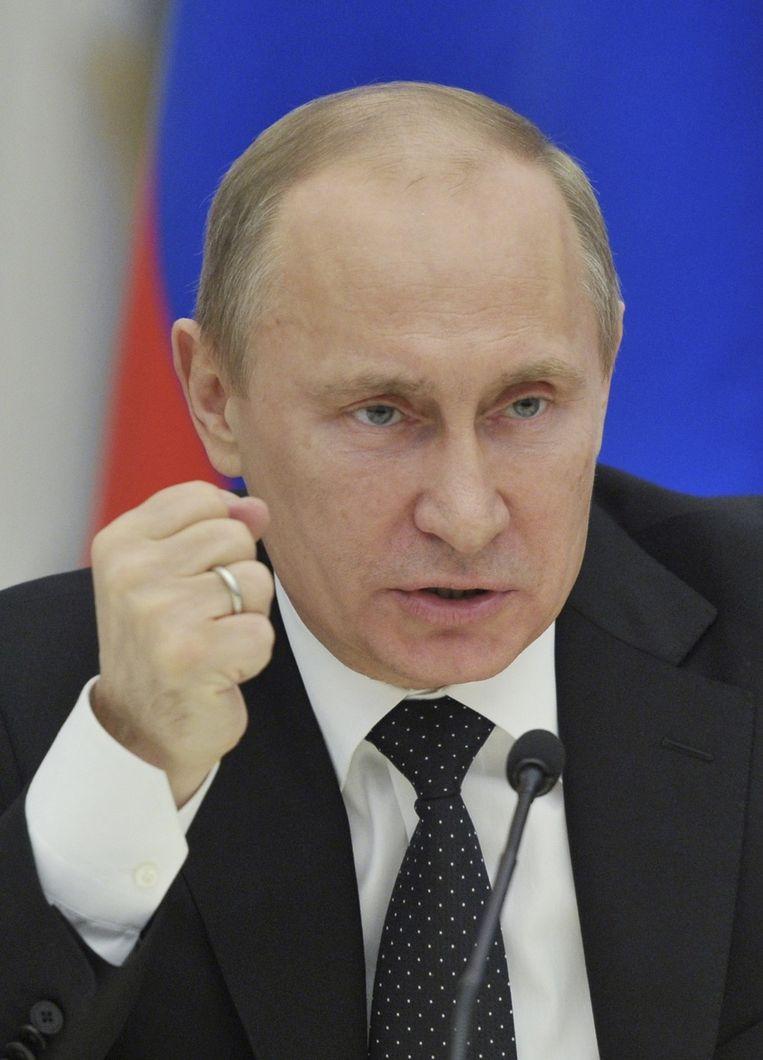 De Russische presodent Vladimir Poetin is ook de gewezen KGB-baas. Beeld REUTERS