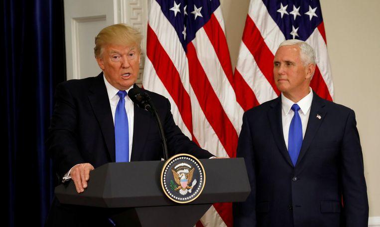 Mike Pence naast de Amerikaanse president Donald Trump. Beeld REUTERS