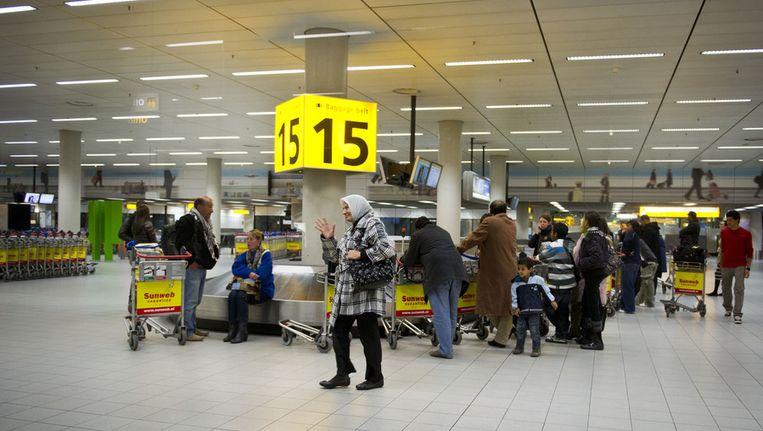Reizigers uit Egypte op Schiphol Beeld ANP