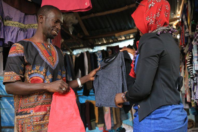 Yancouna Jadama (29) Verkoper van tweedehandskleding in Brikama. Werd ontvoerd in Libië. Beeld CreditAlhagie Manka