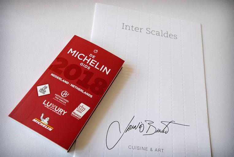 De vorige editie van de Michelin-gids, die komende maandag gepresenteerd zal worden.  Beeld ANP