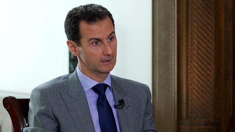 Een foto van Bashar al-Assad, beschikbaar gemaakt door het Syrische staatspersbureau. Beeld epa