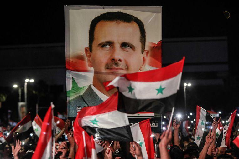 In Damascus wordt de uitslag gevierd. Beeld AFP