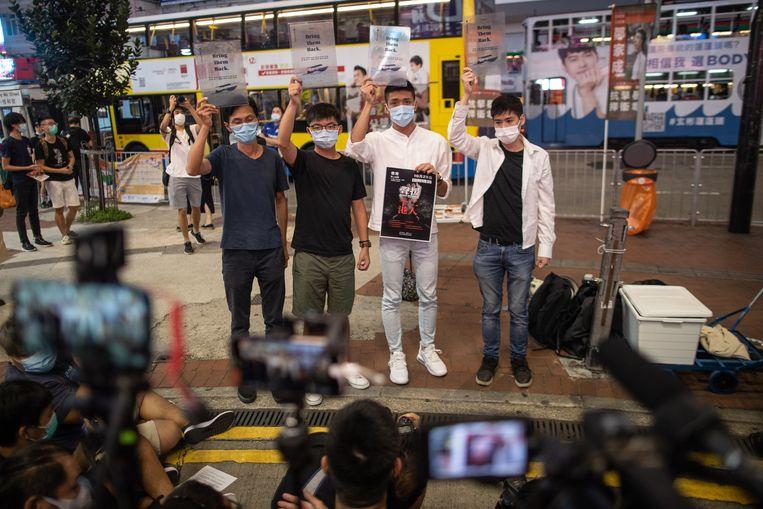 Activisten voor democratie in Hongkong. Sinds Beijing zijn greep op de voormalige Britse kolonie heeft versterkt,  vluchten Hongkongse activisten om aan arrestatie te ontkomen, onder meer naar Taiwan. Beeld EPA