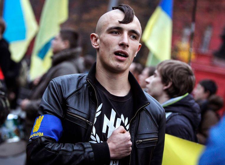 Een activist van de Oekraïense partij Svoboda. Beeld reuters