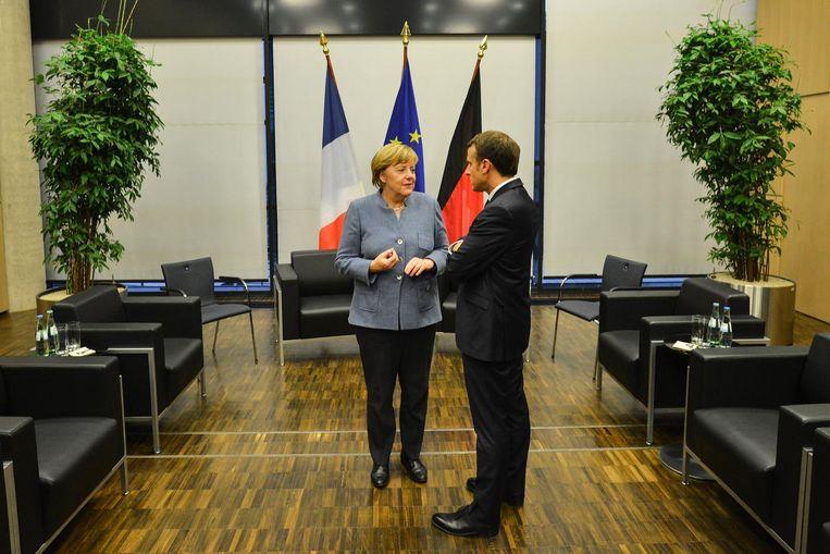 Angela Merkel en Emanuel Macron tijdens de klimaattop in Bonn. Beeld epa