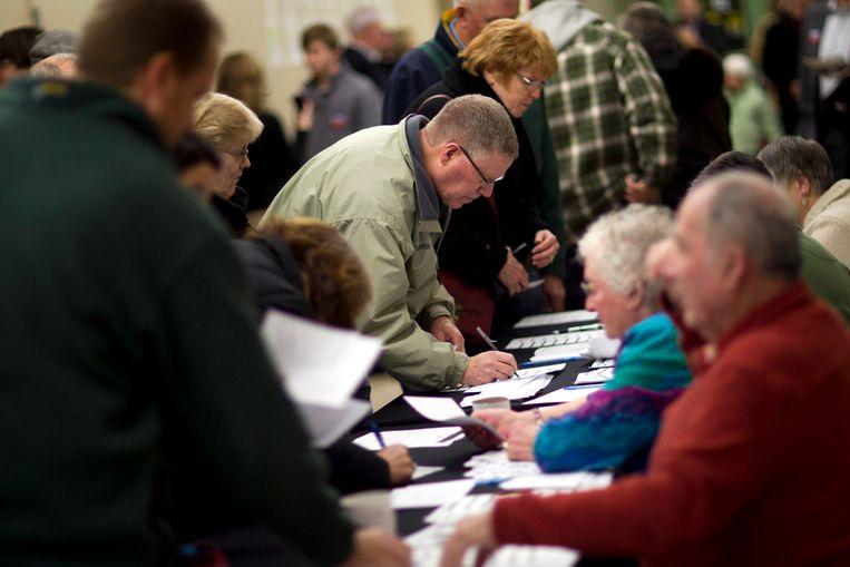 De Republikeinse caucus van 2012 in Waukee, Iowa. Beeld AP