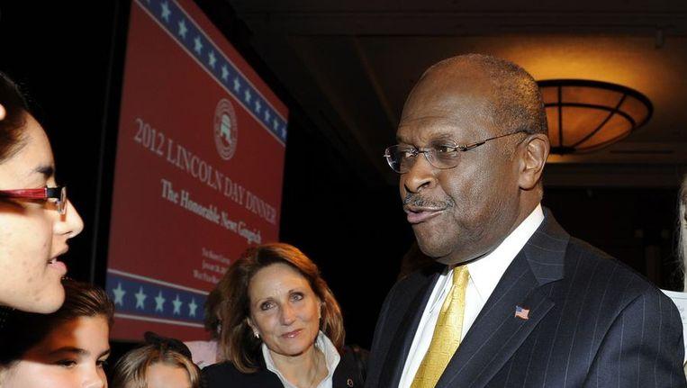 Herman Cain gisteravond nadat hij zijn steun aan Newt Gingrich heeft gegeven. Beeld reuters
