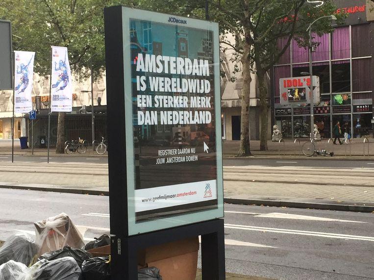 De reclameposter van dotAmsterdam op de Coolsingel in Rotterdam. Beeld Rotterdams Dagblad