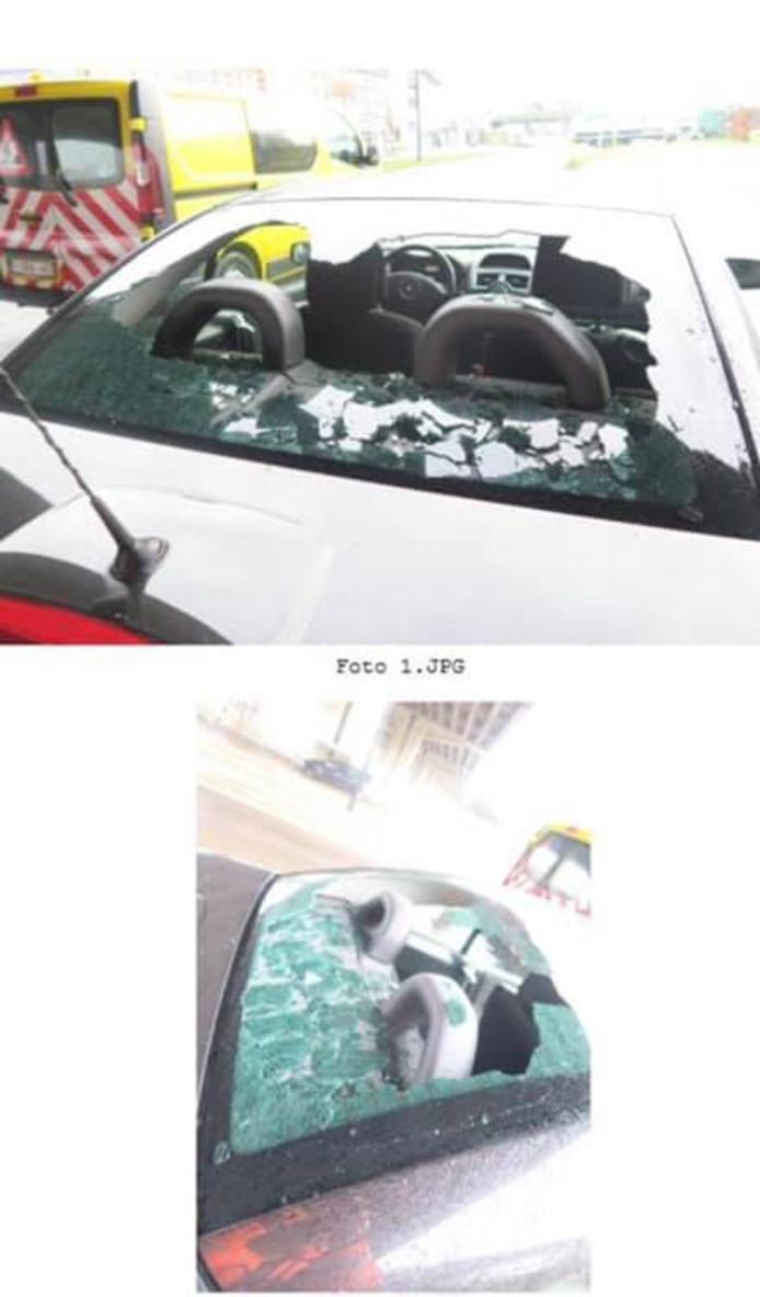 Een stuk beton ging dwars door de achterruit van een voorbijrijdende auto.