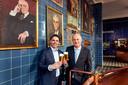 Peer Swinkels, rechtsboven met zijn voorganger als topman van het familiebedrijf, zijn neef Jan-Renier.