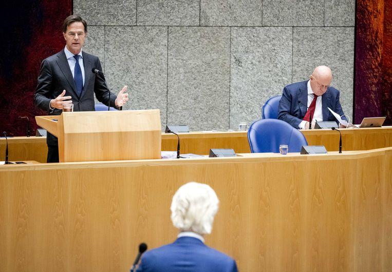Premier Mark Rutte, Geert Wilders (PVV) en Ferdinand Grapperhaus, minister van Justitie en Veiligheid, tijdens een debat over de moord op Samuel Paty. Beeld ANP