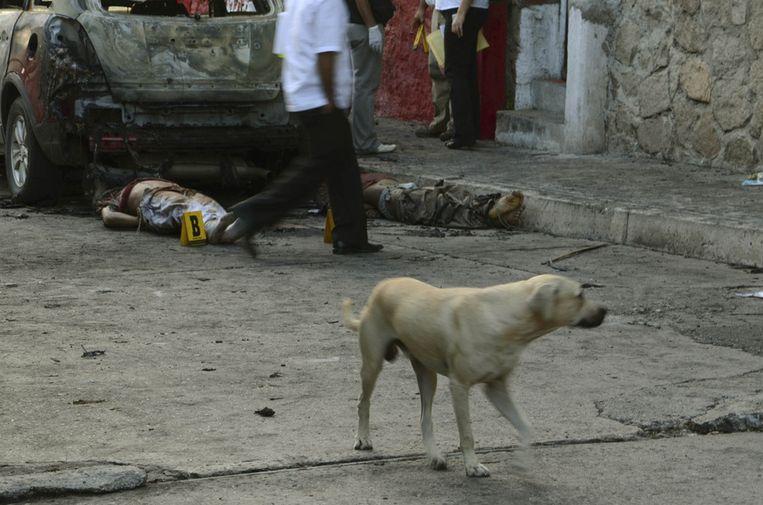 Twee slachtoffers van de drugsoorlog. Beeld ap