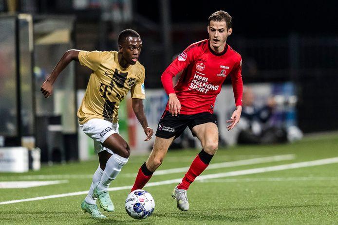 HELMOND  - 16-09-2021, SolarUnie stadion. Dutch Keuken Kampioen Division, season 2021-2022. Jong FC Utrecht player Djevencio van der Kust, Helmond sport player Sander Vereijken during the match Helmond Sport - Jong Utrecht.
