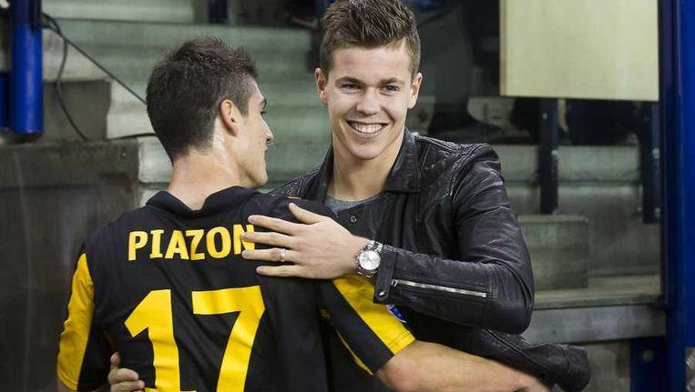 Man van de wedstrijd Lucas Piazon viert een treffer met oud-Vitessenaar Marco van Ginkel. Beeld anp