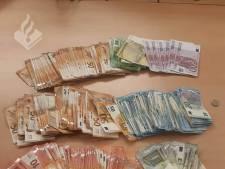 Politie houdt vijf mensen aan in Liers pand vol geld en drugs