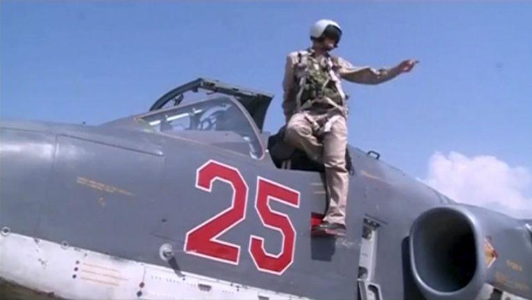 Een Russische piloot keert terug na een missie boven Syrië. Beeld reuters
