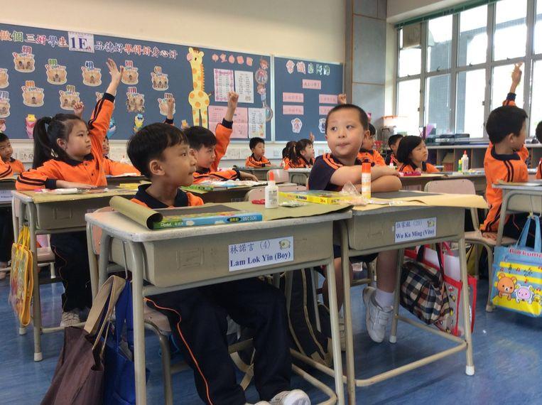 De klas van Vito van de Boeddhistische Wijsheid-school in Hongkong. Beeld Marije Vlaskamp