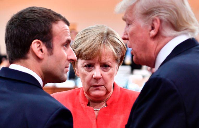 Emmanuel Macron,  Angela Merkel en Donald Trump - hier nog samen op de G20 van vorig jaar - onderschrijven de veroordeling van Rusland door Brits leider Theresa May. Beeld AFP