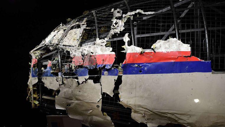De romp van de MH17, tentoongesteld tijdens de presentatie van het onderzoeksrapport over de vliegramp. Beeld afp