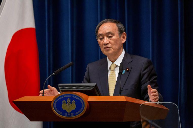 De Japanse premier Yoshihide Suga kondigt strenge coronamaatregelen aan. Beeld REUTERS