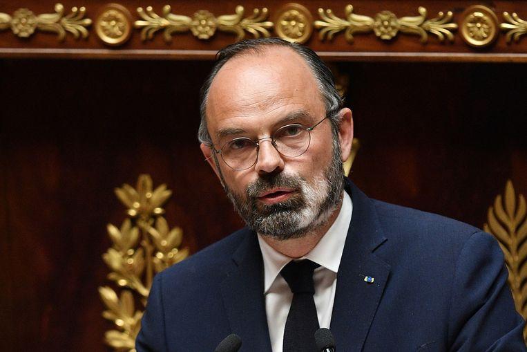 De Franse premier Édouard Philippe spreekt  de Assemblée in Parijs toe. Beeld AFP