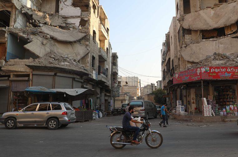 Beschadigde gebouwen in het Syrische rebellenbolwerk Idlib.  Beeld AFP