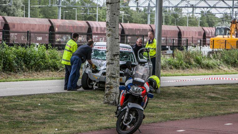 De raceauto die tijdens de Amsterdam Short Rally 2013 uit de bocht vloog. Er vielen twee doden, onder wie Oscar Beeld Amaury Miller