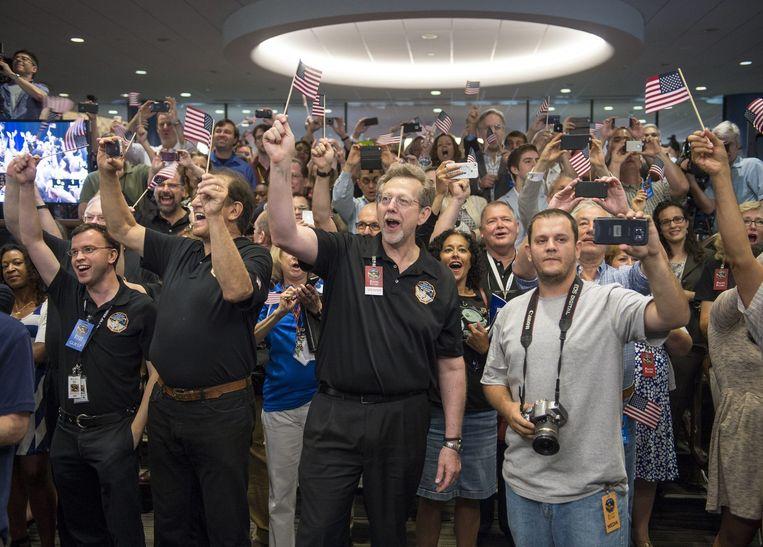 NASA, toen afgelopen zomer de sonde New Horizons langs Pluto scheerde. Een socialemediastrategie was van tevoren precies uitgestippeld. Beeld EPA