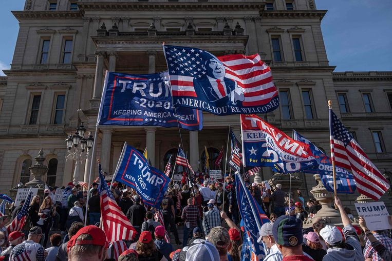 Hordes Trump-fans in Lansing, Michigan. Beeld AFP