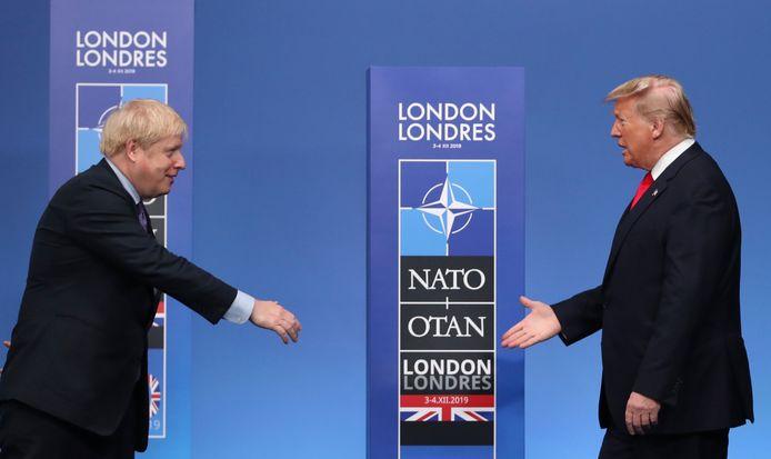 De Britse premier Boris Johnson (links) verwelkomt de Amerikaanse president Donald Trump tijdens de NAVO-top in Londen begin december.