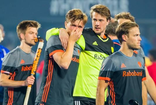 Teleurstelling bij Jorrit Croon, keeper Sam van der Ven, Jeroen Hertzberger (Ned) en links Thierry Brinkman (Ned) na de verloren shoot outs na de finale tussen België en Nederland (0-0) bij het WK Hockey. Belgie wint de shoot outs