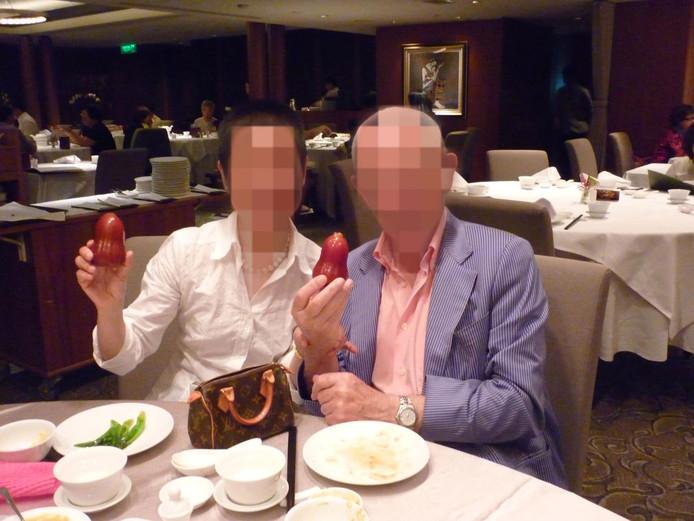 Herman van O. (rechts op de foto) werd opgepakt omdat hij voor 41 miljoen zou hebben gefraudeerd.