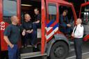 De brandweermannen die het vuur in de Elleboogkerk bedwongen. Rechts Leo Stapelbroek.