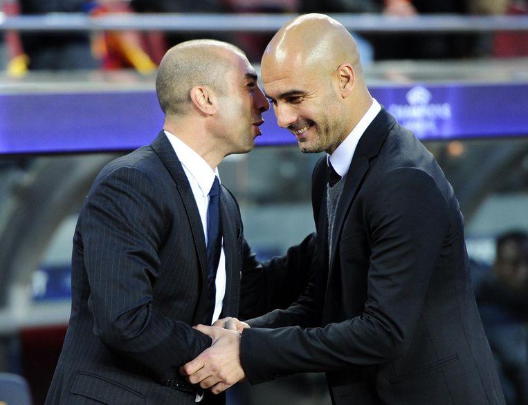 Pep Guardiola, de huidige manager van Manchester City, schudt de hand van Di Matteo. Beeld anp