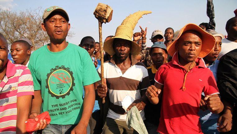 Mijnwerkers bij de platinamijn in Rustenburg. Beeld getty