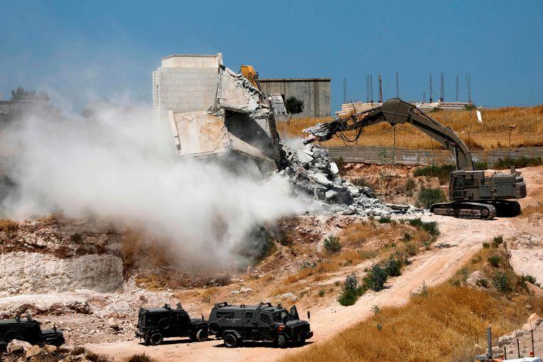 Israël vernietigt een Palestijns huizencomplex in Oost-Jeruzalem. Beeld AFP