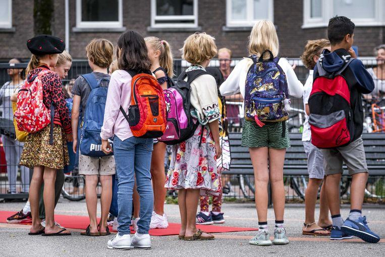 Leerlingen van basisschool OBS De Notenkraker in Amsterdam.  Beeld ANP