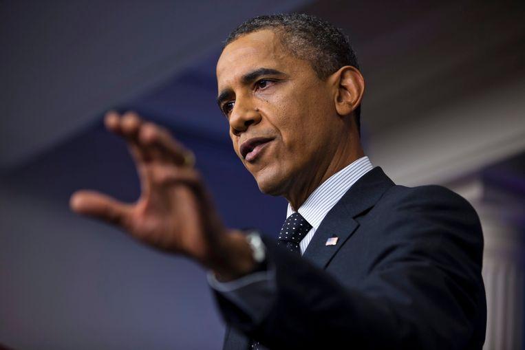 President Obama gisteren tijdens zijn verrassings-persconferentie in het Witte Huis, waar hij de druk op de Republikeinse partij nog wat verder opvoerde. Beeld EPA