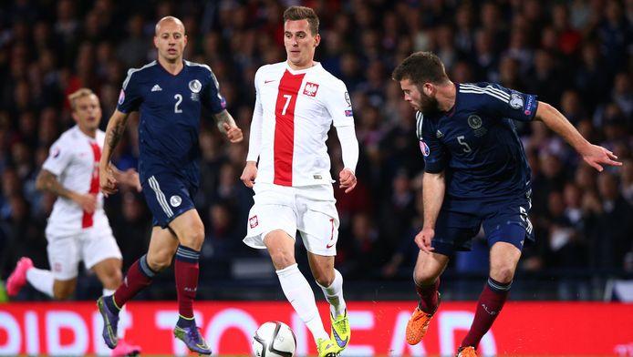 Milik in actie voor Polen tegen Schotland.
