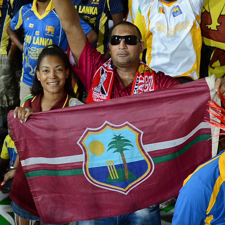 Supporters van cricketgrootmacht 'West Indies'. Dat is geen land, maar een verzameling Caraïbische eilanden die onder een speciaal voor dit doel ontworpen vlag interlands spelen. Beeld AFP