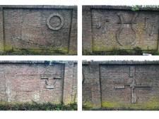 Het doek valt voor ingemetselde symbolen in muur in Etten-Leur die in de weg staat voor nieuwbouwplan