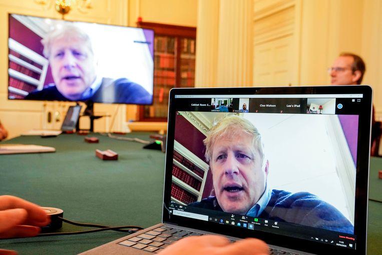 Johnson tijdens een videomeeting over Covid-19.  Beeld via REUTERS