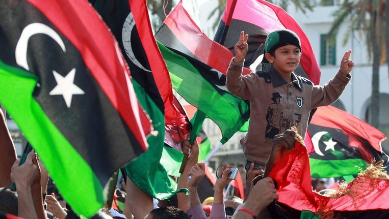 Feestende Libiërs in Tripoli, vandaag. Beeld afp