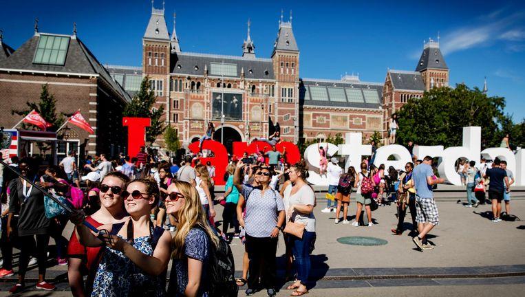 Massatoerisme in Amsterdam Beeld anp