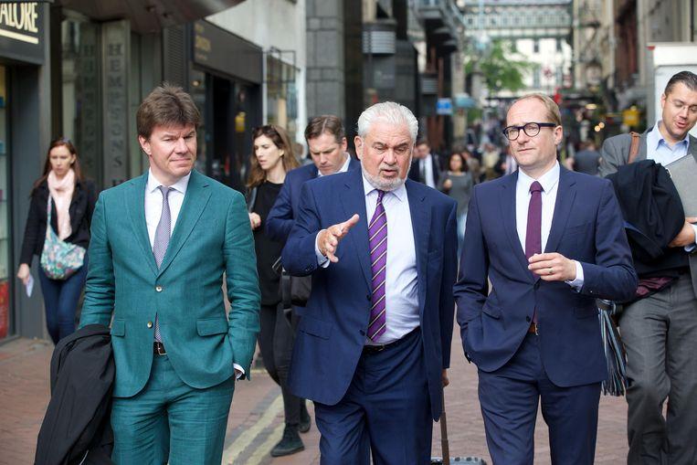 Sven Gatz, Fernand Huts en Ben Weyts in Londen. Beeld BELGA