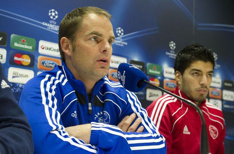 Luis Suárez (rechts) naast zijn toenmalig coach Frank de Boer Beeld anp